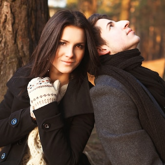 Woman wearing gloves posing with her boyfriend