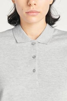Woman wearing a gray collared shirt