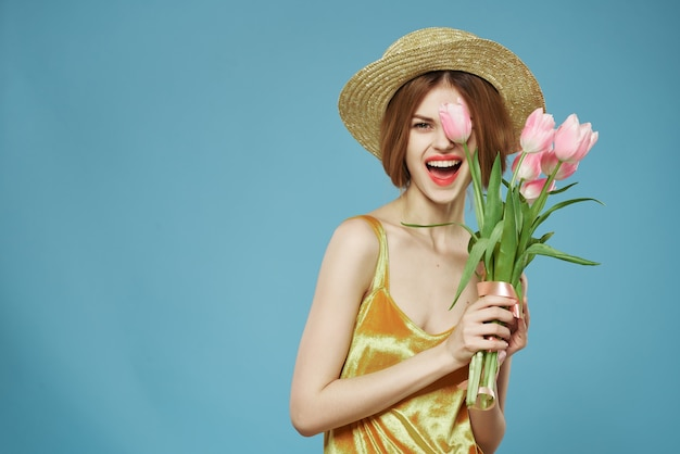 Woman wearing a hat bouquet of flowers a gift for womens day