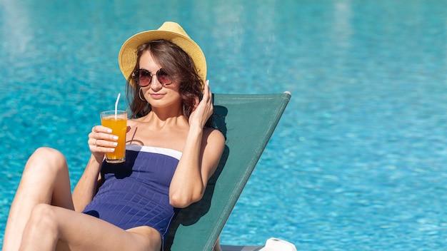 Woman wearing hat laying on lounge