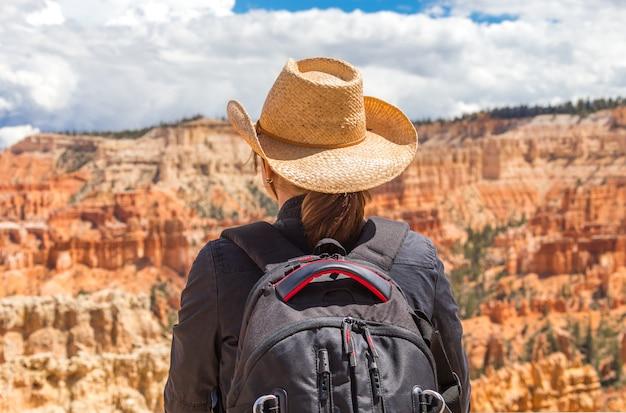 Woman wearing hat looking at the bryce canyon, utah usa