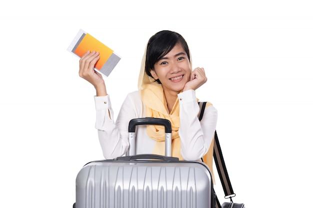 Woman wearing head scarf holding suitcase