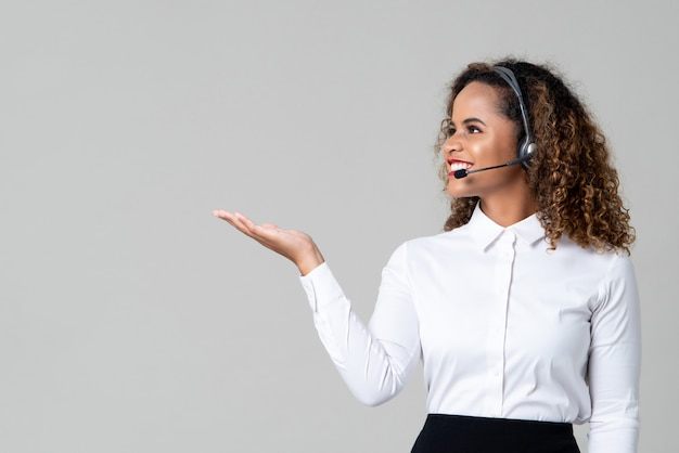 Woman wearing headphones as a call center staff with hand open
