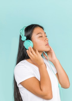 Woman wearing headphones with her eyes closed