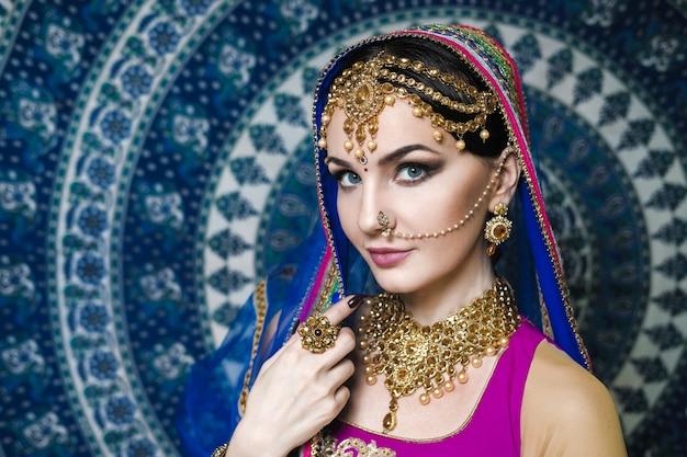 Woman wearing indian sari dress with jewellery