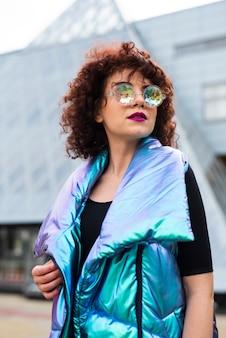 Woman wearing iridescent vest