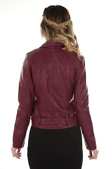Woman wearing a jacket in studio