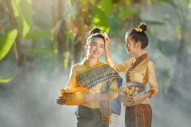 Woman wearing laos traditional dress costume, vintage style, laos culture, laos