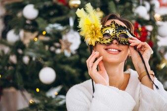 Woman wearing mask on Christmas