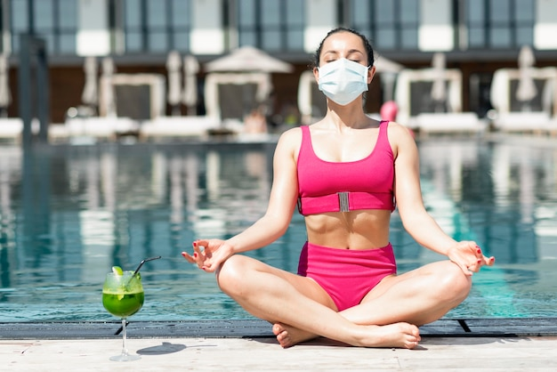 Woman wearing mask at pool