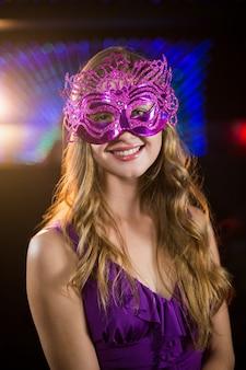 Woman wearing masquerade in bar