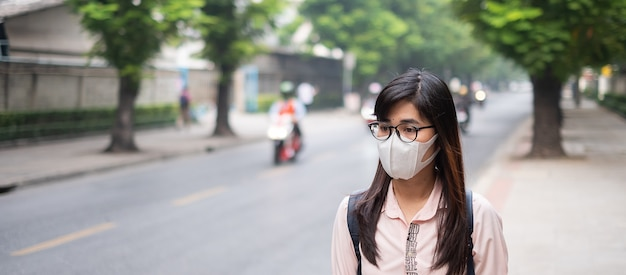 Woman wearing n95 respiratory mask protect and filter pm2.5