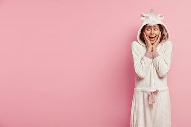 Woman wearing pajamas with bunny ears