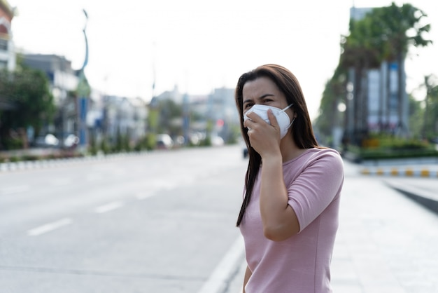 Woman wearing protective face mask for coronavirus and pm 2.5 fighting