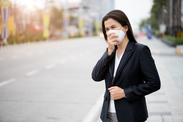 Woman wearing protective face mask and cough, coronavirus and pm 2.5 fighting