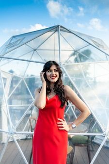 Woman wearing red dress outdoor summer portrait