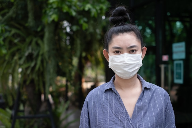 Woman wearing on a respirator n95 mask outdoors