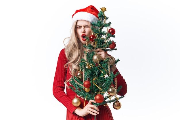 サンタクロースの衣装を着ている女性の休日のクリスマスのおもちゃの伝統