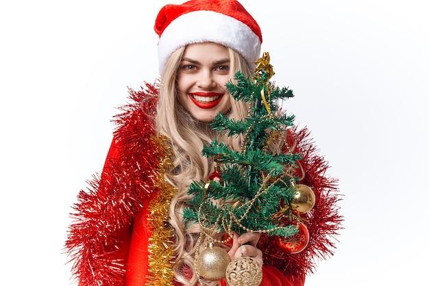 サンタの衣装の装飾の休日のクリスマスファッションを着ている女性