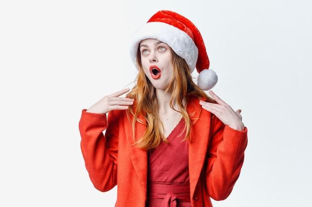 サンタコスチュームファッション高級ポーズホリデークリスマスを着ている女性