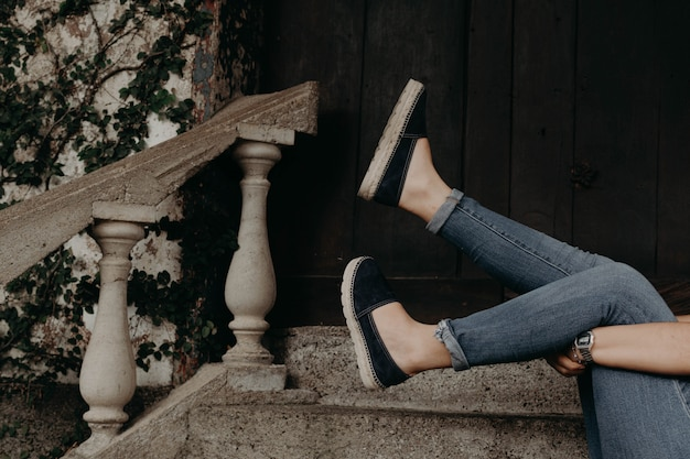 Woman wearing shoes and sandals, modeling outdoor