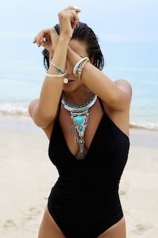 Woman wearing silver jewelry on the beach