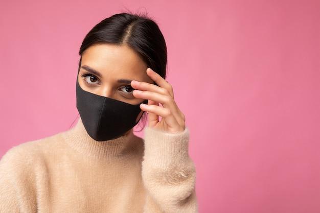 Woman wearing stylish protective face mask