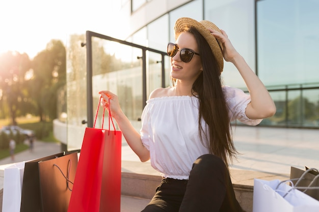 Woman wearing summer hat black friday shopping concept