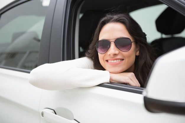 Woman wearing sunglasses smiling at camera