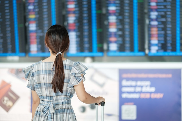 Woman wearing surgical face mask in airport