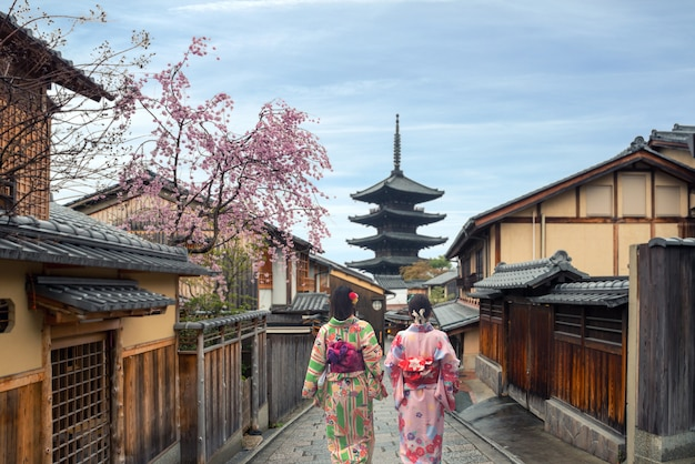Woman wearing traditional japanese kimono in yasaka pagoda and sannen zaka street in kyoto, japan