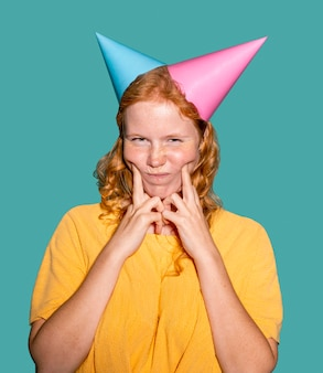 Woman wearing two birthday cones