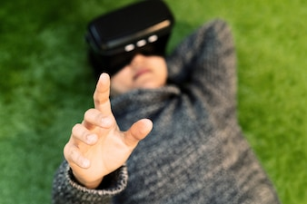 Woman wearing virtual reality glasses. Smartphone using with VR headset