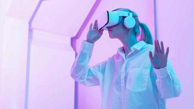 Woman wearing virtual reality simulator