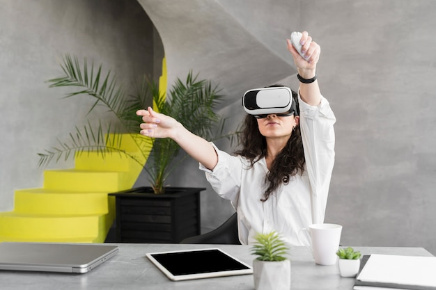 Woman wearing a vr set and remote