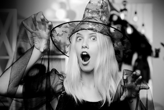 Woman wearing witch hat for halloween