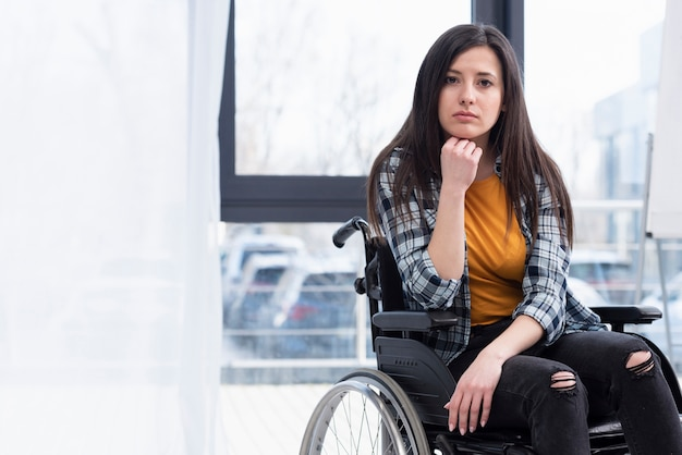 Woman in wheelchair being sad