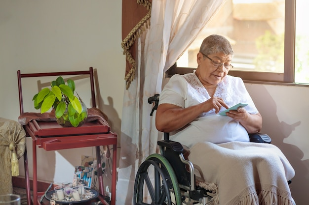 Woman in wheelchair chatting on cell phone