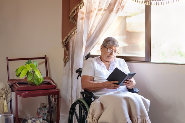 Woman in a wheelchair reading a book