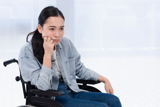 Woman in wheelchair thinking