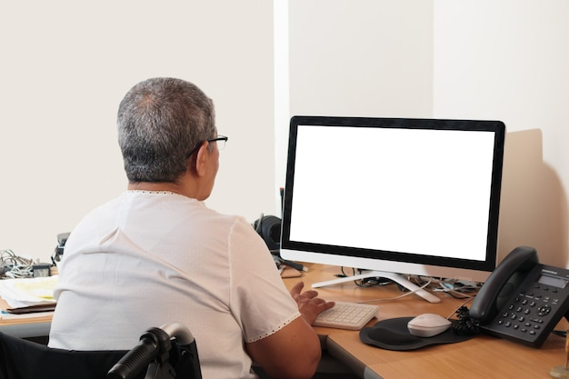 Woman in a wheelchair working on the computer