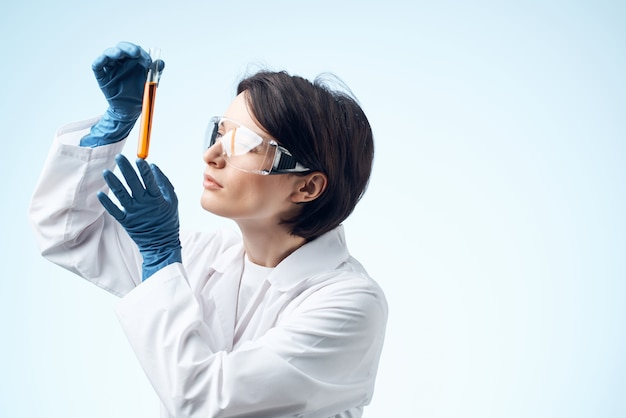 Woman in white coat test tube chemical solution analysis diagnostics