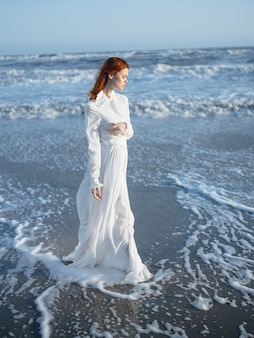 Woman in white dress beach travel vacation landscape