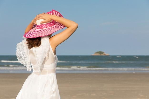 Woman in white dress on beach