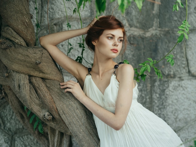 Woman in white dress and green leaves luxury nature model. high quality photo