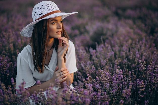 Woman in white dress in a lavander field