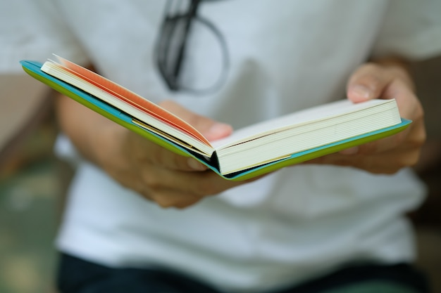 Woman in white shirt holding book to read ,business concept. business idea