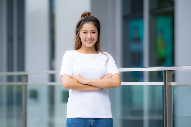 Woman in white t-shirt and blue jeans