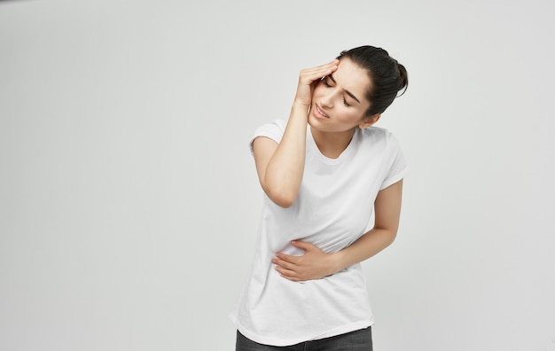 Woman in white t-shirt health problems body pain discomfort