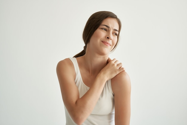 Woman in white t-shirt joint pain problems with rheumatism. high quality photo